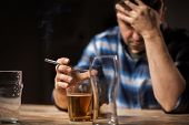 alcoholism, alcohol addiction and people concept - close up of male alcoholic drinking beer and smok poster