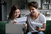 Happy Young Couple Excited By Reading Good News In Paper Letter About Refund Tax Money, Millennial M poster