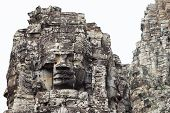 Stone Face Tower Of Ancient Buddhist Temple Bayon In Angkor Wat Complex, Cambodia. Ancient Architect poster