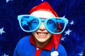 pic of young boy  - boy in big glasses making a funny face - JPG