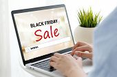 Woman Hands Typing Laptop Computer With Www. On Search Bar Over Black Friday Sale Web Banner Backgro poster