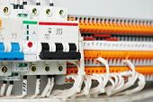 Automatic electrical fuseboxes and power lines located inside of an industrial switch control panel