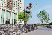 Young Handsome Man With Beard On A Skateboard Jumping High And Making Trick poster