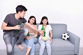 Concept Of Cheering. Asian Teenagers Watching Football On Television. People Are Cheering And Winnin poster