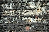 picture of asura  - Sculptured buddhas on wall of Terrace of the Elephant Cambodia