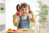 Healthy Kids Nutrition Concept. Cute Toddler Girl Sitting At Table With Plate Of Salad, Vegetables,  poster