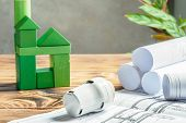 Thermostatic Head Valve For Radiator Heater And Green House Of Cubes On Wooden Background Heating Pr poster