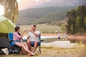 Family Enjoying Camping Vacation By Lake Together poster