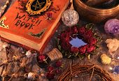 Witch Book With Magic Rose Mirror, Pentagram And Mystic Objects On Planks. Occult, Esoteric And Divi poster