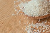 Natural Brown Sugar Or No Bleach Sugar On Wooden Spoon. Organic Brown Sugar Put On Wood Table In Clo poster