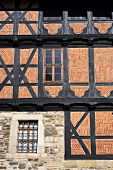 Half-timbered medieval building in the historical center of Goslar, Germany.                         poster