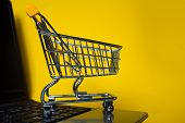 End Of Online Sales, Concept. Online Shopping, Shopping Cart On Laptop Keyboard. Shopping In Online  poster