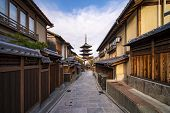 Walkway In Kyoto Traditional Home And Old Market With Yasaka Pagoda Background, Japan. This Backgrou poster