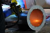 Welder Performs Welding Work Semi-automatic Electric Arc Welding. Stainless Steel Pipe Welding. Mig  poster