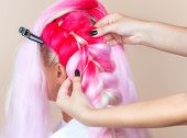 The Hairdresser Weaves Braids With Pink Kanekalons Beautiful Blonde Beauty Salon.beautiful Hairstyle poster