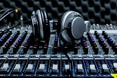 Close-up Of Boutique Recording Studio Control Desk, Dj Headphones For Professional Disc,  Equipment poster