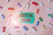 Conceptual Hand Writing Showing Advertising Revenue. Business Photo Showcasing Money Media Earn From poster