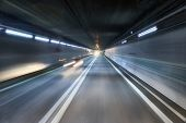 Highway tunnel high speed driving motion blur concept poster