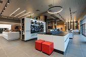 Interior of premium apliance store showroom, ovens and other home appliance at background poster