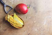 Raw Organic Dried Mango And Fresh Ripe Mango Fruit On Rustic Table. Healthy Eating, Raw Food Or Diet poster