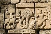 image of bestiality  - Ancient Khmer carving showing cattle being abducted and assaulted.  Outer wall of Baphuon Temple, part of the Angkor Thom complex in Cambodia.  