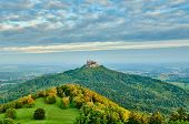 Hilltop Hohenzollern Castle on mountain top in Swabian Alps, Baden-Wurttemberg, Germany poster