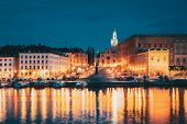 Stockholm, Sweden. Scenic Famous View Of Embankment In Old Town Of Stockholm In Night Lights. Great  poster