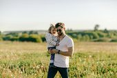 Family, Parenthood And Fatherhood Concept - Loving Father Holding Little Baby Daughter Outdoor poster