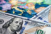 Us Dollars On The Map Of Europe. Concept Of Trade Between The United States And Europe, Exchange Rat poster