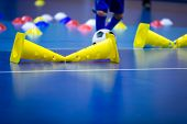 Indoor Soccer Player On Training During The Winter. Futsal Training Field With Blue Cones. Indoor Fo poster