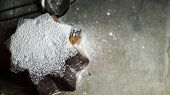 Italian Chocolate Panettone Sprinkled With Powder On A Concrete Background. Top View poster