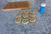 Fresh Baked Sugar Cookies With Blue Sprinkles On Waxed Paper Cooling. poster