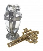 image of chalice antique  - Silver cross chalice and a brass crucifix which are Catholic religious symbols  - JPG