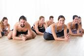 Group Of Young Sporty Attractive People In Yoga Studio, Practicing Yoga Lesson With Instructor, Sitt poster