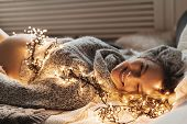 Charming Young Pregnant Woman Lying On Bed With Lights Covering Her Body, She Rests, Dream, Create B poster