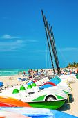 VARADERO,CUBA-APRIL 7:Recreational marina and tourists enjoying the beach April 7,2013 in Varadero.W