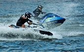 picture of jet-ski  - A jet ski and its rider leap clear of the water - JPG