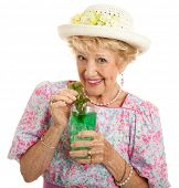 Sweet Southern lady drinking a mint julep for the Kentucky Derby.  Isolated on white.