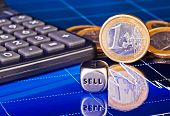 Dices Cube With The Word Sell, Euro Coins, Calculator And Downtrend Financial Chart As Background. S