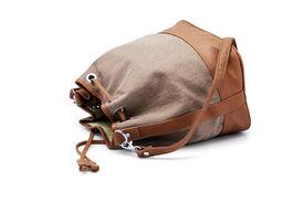 image of sling bag  - Green Lady Sling Bag Lying On White Background - JPG
