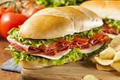 picture of salami  - Homemade Italian Sub Sandwich with Salami Tomato and Lettuce - JPG