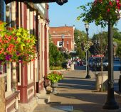 stock photo of quaint  - Colorful sidewalk with quaint shops and flowers in Chagrin Falls Ohio