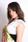 pic of partially clothed  - Pretty young woman with a colorful apron partially covering her white - JPG
