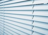 stock photo of jalousie  - White plastic window blinds close studio shot - JPG