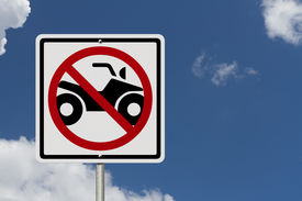 picture of four-wheelers  - An American road sign with sky background with a symbol of an ATV and restricted No ATV allowed - JPG