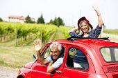 picture of say goodbye  - Senior happy couple driving vintage car - JPG