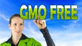 foto of genetic engineering  - GMO Free conceptual image with a girl reaching up to touch text  - JPG
