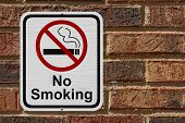 picture of tobacco smoke  - No Smoking Sign Red and White sign with words No Smoking and cigarette symbol on a brick wall - JPG