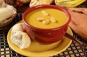 picture of butternut  - a bowl of butternut squash soup with dinner rolls - JPG