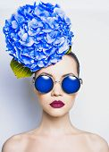 image of surreal  - Fashion portrait of beautiful young lady with blue hydrangea - JPG